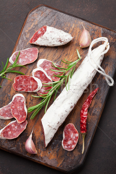 Sliced salami on cutting board Stock photo © karandaev