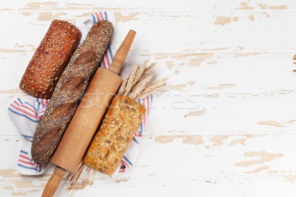 Ekmek beyaz ahşap masa üst görmek Stok fotoğraf © karandaev