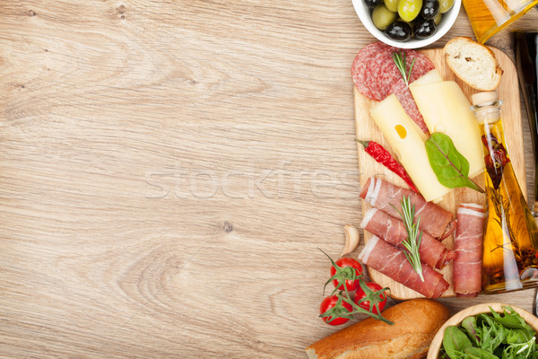 Peynir prosciutto ekmek sebze baharatlar ahşap masa Stok fotoğraf © karandaev