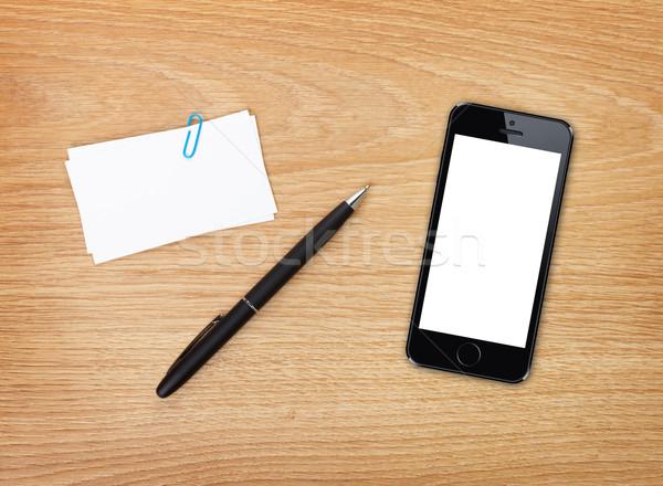 Stylo téléphone portable bureau table au-dessus Photo stock © karandaev