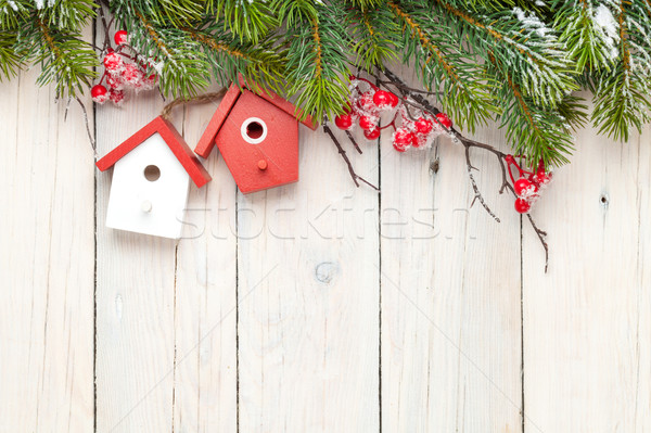Christmas wooden background with fir tree and birdhouse decor Stock photo © karandaev