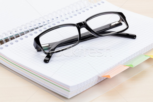 Office table with glasses over notepad Stock photo © karandaev