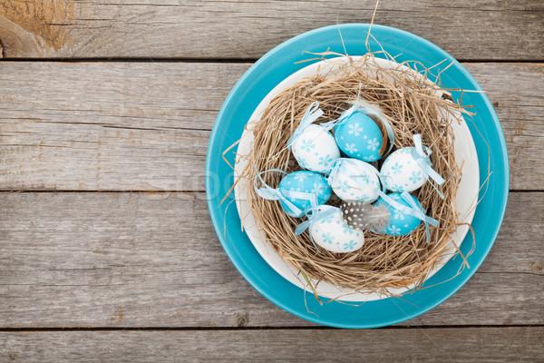 œufs de Pâques nid plaque bois alimentaire heureux Photo stock © karandaev