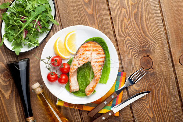 Stock photo: Grilled salmon, salad and condiments