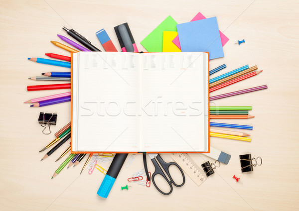 Blank notepad over school and office supplies Stock photo © karandaev