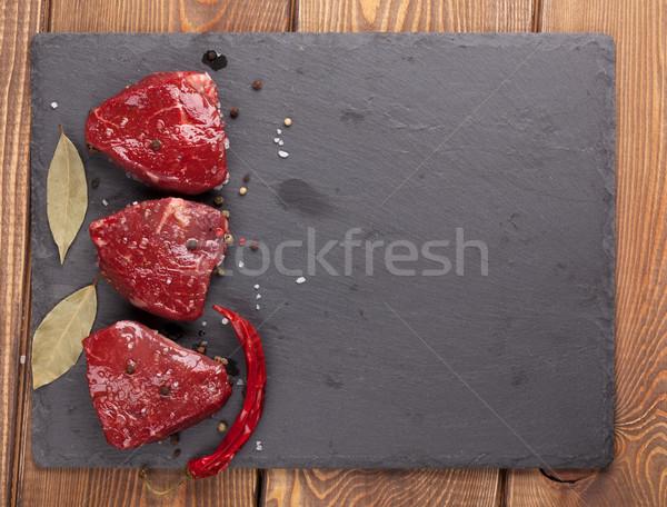 Surowy filet przyprawy kamień pokładzie Zdjęcia stock © karandaev