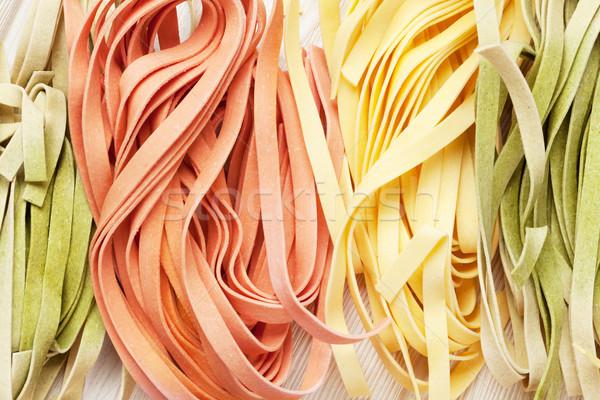 Colorato italiana pasta primo piano legno cucina Foto d'archivio © karandaev