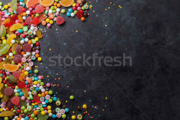 Colorful candies, jelly and marmalade over stone Stock photo © karandaev