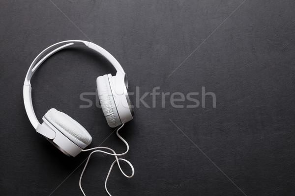 Headphones on leather desk table Stock photo © karandaev