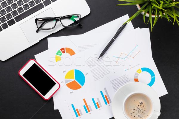 Iroda asztal laptop kávé okostelefon jelentések Stock fotó © karandaev