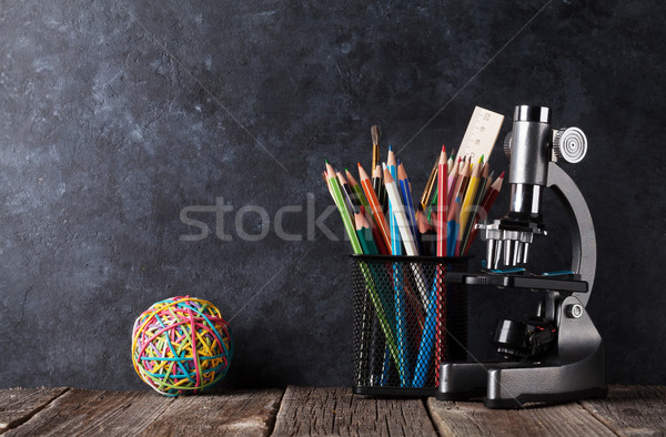 Supplies and microscope in front of chalk board Stock photo © karandaev