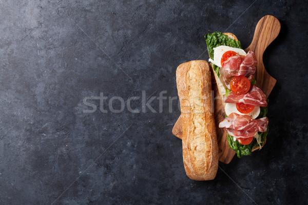 Sandwich with salad, prosciutto and mozzarella Stock photo © karandaev