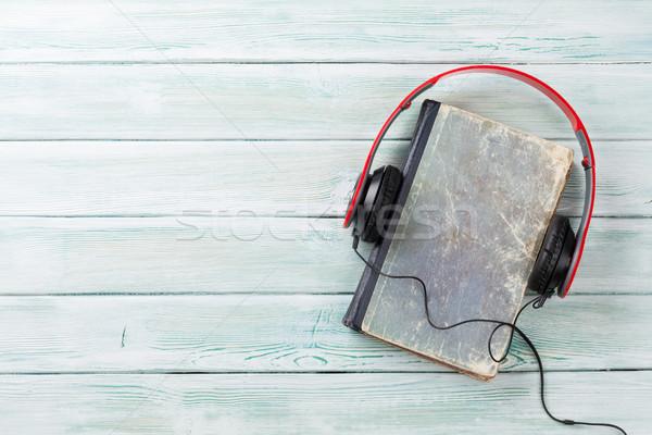 Audio könyv fejhallgató öreg könyvek fa asztal Stock fotó © karandaev