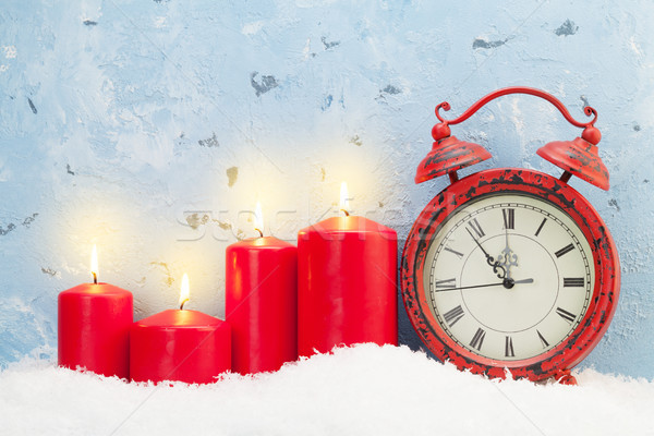 Christmas candles and clock Stock photo © karandaev