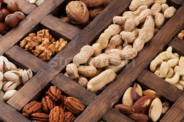 Various nuts in wooden box Stock photo © karandaev