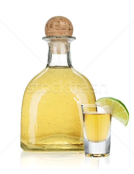 Fles goud tequila geïsoleerd witte glas Stockfoto © karandaev
