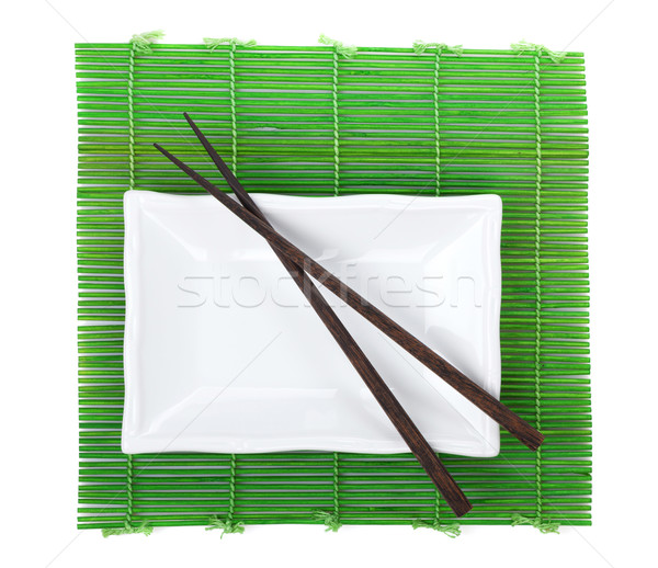 Chopsticks and utensils over bamboo mat Stock photo © karandaev