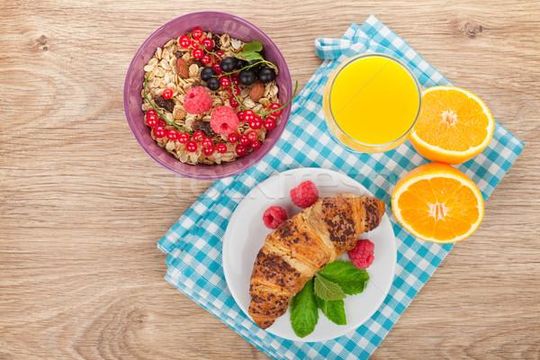 Sağlıklı kahvaltı müsli karpuzu portakal suyu kruvasan Stok fotoğraf © karandaev