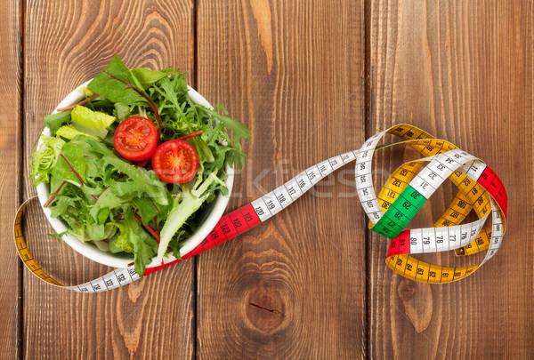 Fita métrica alimentação saudável mesa de madeira fitness saúde comida Foto stock © karandaev