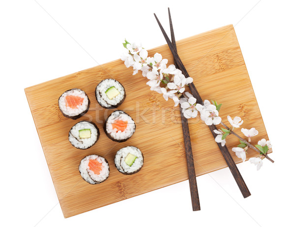 Sushi maki set with salmon and cucumber and sakura branch Stock photo © karandaev