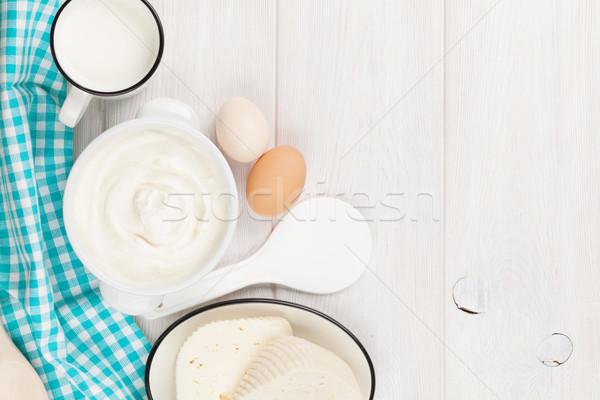 Tejföl tej sajt tejtermékek fa asztal felső Stock fotó © karandaev