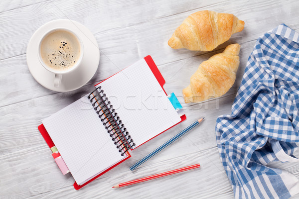 Fresh croissants, coffee and notepad Stock photo © karandaev