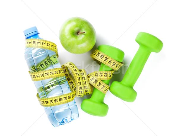 Halteres garrafa de água maçã fita métrica fitness isolado Foto stock © karandaev