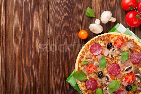 Italian pizza with pepperoni, tomatoes, olives and basil Stock photo © karandaev
