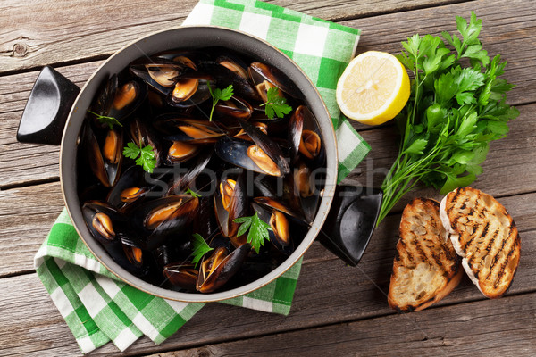 Mussels and bread toasts Stock photo © karandaev
