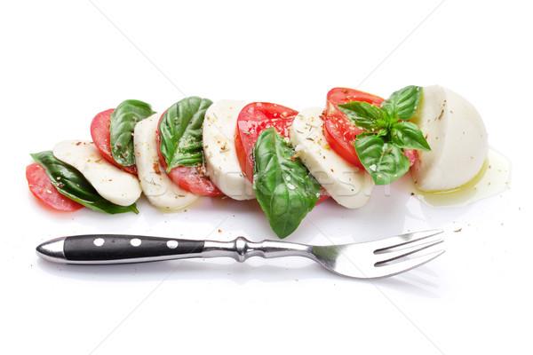 Caprese salatası çatal mozzarella peynir domates fesleğen Stok fotoğraf © karandaev