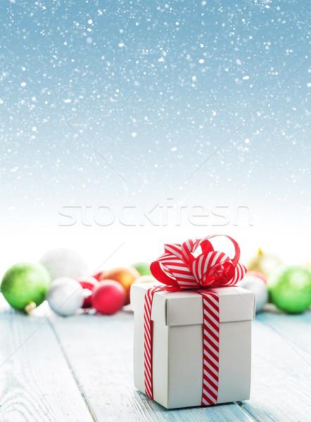Christmas gift box and colorful baubles decor Stock photo © karandaev