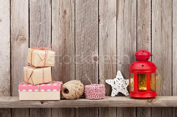 Natale candela lanterna regali legno Foto d'archivio © karandaev