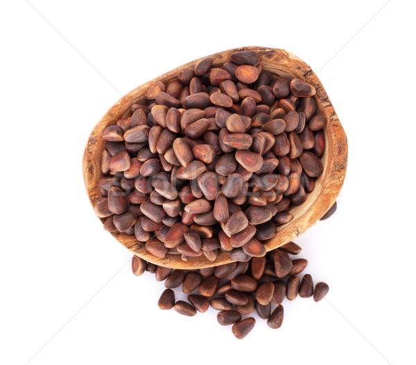 Сток-фото: соснового · орехи · чаши · изолированный · белый · фон