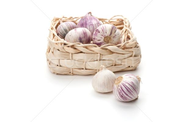 Pack and two head of garlic Stock photo © karandaev