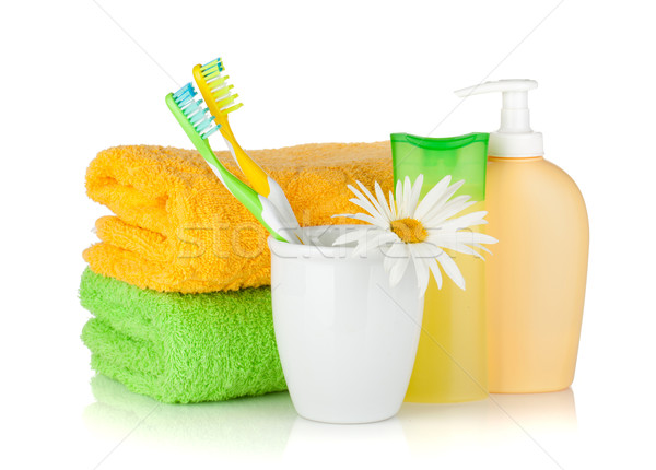 Toothbrushes, shampoo bottles, two towels and flower Stock photo © karandaev