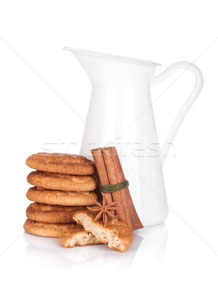 Kancsó tej sütik izolált fehér üveg Stock fotó © karandaev