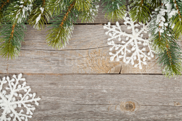 Christmas fir tree and decor on wooden board background Stock photo © karandaev