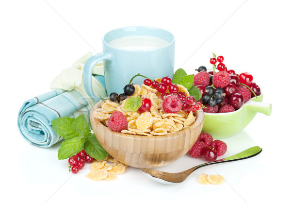 Fresh corn flakes with berries and milk Stock photo © karandaev