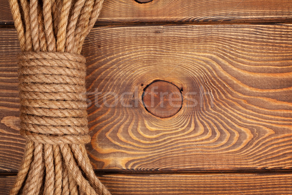 Wooden background with marine rope Stock photo © karandaev