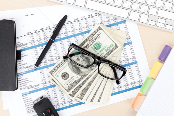 Office table with pc, supplies and money cash Stock photo © karandaev