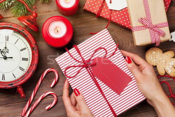 Female hands holding gift Stock photo © karandaev