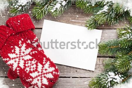 Noel tebrik kartı eldiveni ahşap masa üst Stok fotoğraf © karandaev