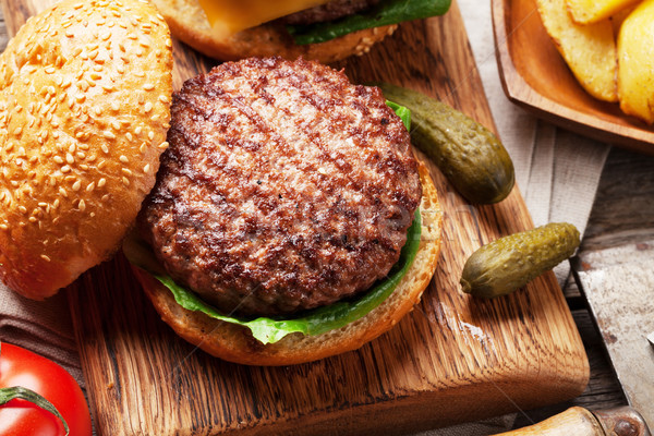 Tasty grilled home made burger Stock photo © karandaev