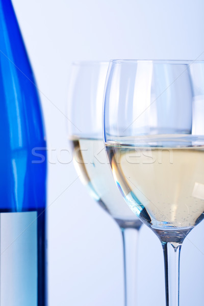 Kék üveg fehérbor kettő borospoharak gamma Stock fotó © karandaev
