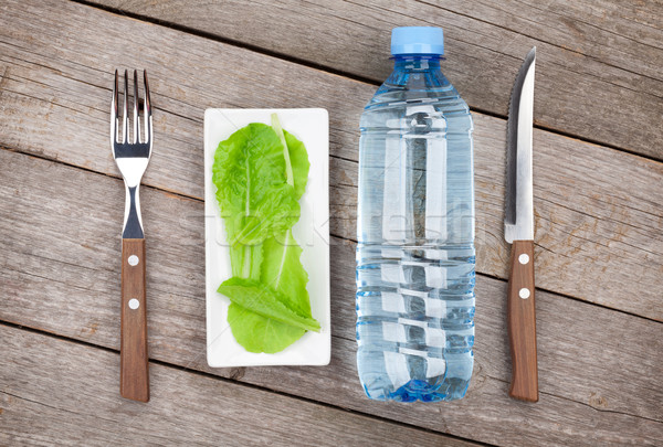 Green salad leaves and water bottle. Healthy food Stock photo © karandaev