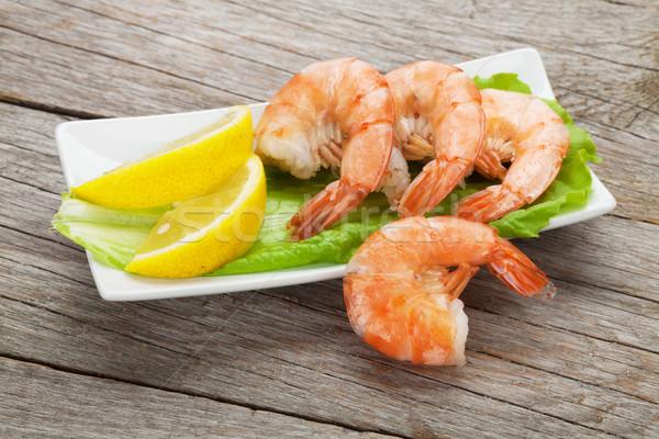Cooked shrimps with lemon and salad leaves Stock photo © karandaev