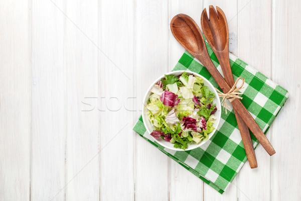 Fresh healthy salad and kitchen utensils Stock photo © karandaev
