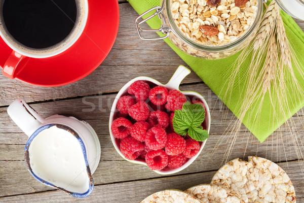 健康 朝食 ミューズリー ミルク 液果類 木製のテーブル ストックフォト © karandaev