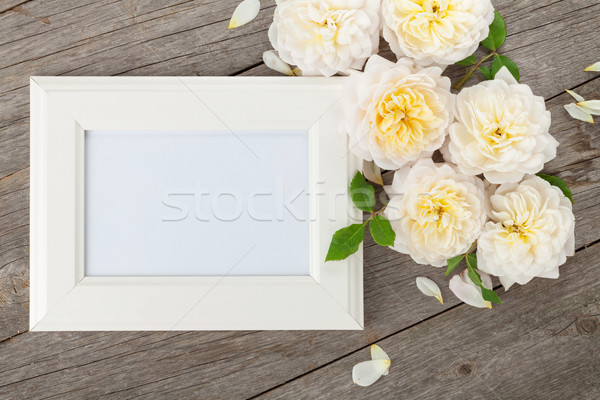 Blank photo frame and white roses Stock photo © karandaev