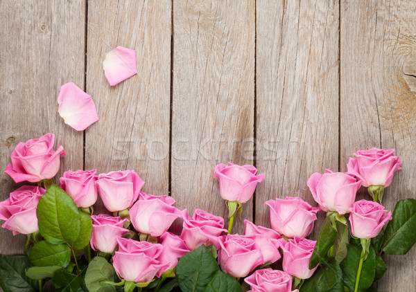 Valentines day background with pink roses over wooden table Stock photo © karandaev